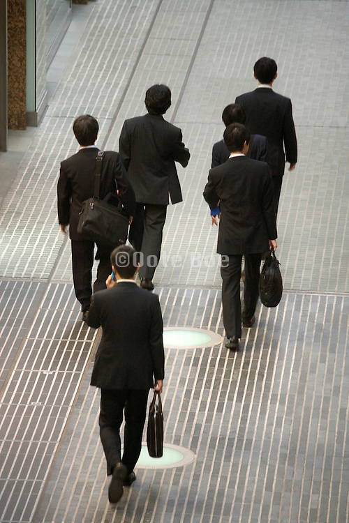 group of businessmen walking and talking