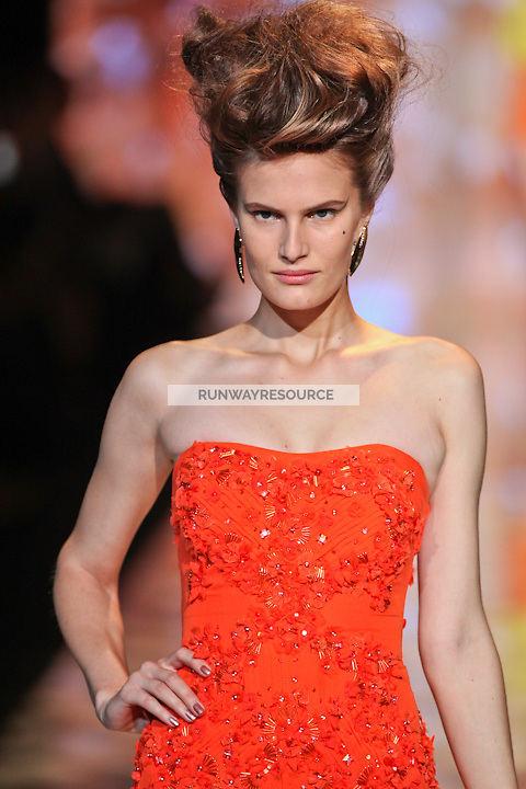 Alla Kostromichova walks the runway wearing Badgley Mischka Spring 2012 Collection during Mercedes-Benz Fashion Week in New York on September 13, 2011