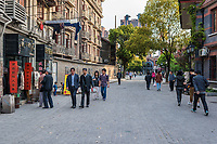 Shanghai, China - April 7, 2013: people walking in the pedestrian way of duolon road at the city of Shanghai in China on april 7th, 2013
