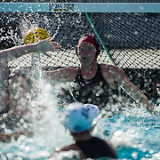 11 February 2018: The San Diego State  women's water polo team competes in day two of the Triton Invitation on the campus of UCSD.]San Diego State Aztecs goalkeeper Maura Cantoni (1) blocks a shot in the fourth quarter. The Aztecs took on the #23 CSUN Matadors Sunday morning and came away with a 7-5 win.<br /> More game action at www.sdsuaztecphotos.com