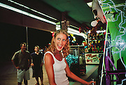 Woman playing an arcade game that simulates electrocution
