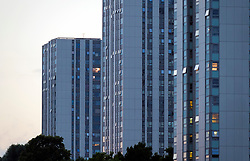 © Licensed to London News Pictures. 24/06/2017. London, UK. Lights on in widows of the Chalcots estate in Swiss Cottage, Camden, showing residents who have refused to leave on the evening of June 24th. Residents have been asked to leave their apartments on the north london estate after government tests found cladding on the building were flammable, making the buildings unsafe. Photo credit: Andre Camara/LNP