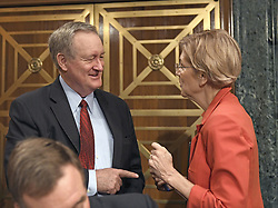 "October 3, 2017 - Washington, District of Columbia, United States of America - United States Senator Mike Crapo, Chairman, US Senate Committee on Banking, Housing, and Urban Affairs, left, shares conversation with US Senator Elizabeth Warren (Democrat of Massachusetts) , right, prior to hearing testimony from Timothy J. Sloan, Chief Executive Officer and President, Wells Fargo & Company, at a hearing entitled, ""Wells Fargo: One Year Later'' on Capitol Hill in Washington, DC on Tuesday, October 3, 2017. .Credit: Ron Sachs / CNP (Credit Image: © Ron Sachs/CNP via ZUMA Wire)"