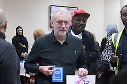Finsbury Park Mosque, London, February 7th 2016. Labour leader and local MP Jeremy Corbyn holds an English copy of the Qur'an during a visit to Finsbury Park Mosque as part of a Visit My Mosque initiative by the Muslim Council of Britain to show non-Muslims &ldquo;how Muslims connect to God, connect to communities and to neighbours around them&rdquo;.<br /> . ///FOR LICENCING CONTACT: paul@pauldaveycreative.co.uk TEL:+44 (0) 7966 016 296 or +44 (0) 20 8969 6875. &copy;2015 Paul R Davey. All rights reserved.