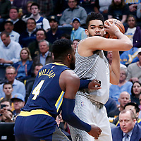 05 April 2018: Minnesota Timberwolves center Karl-Anthony Towns (32) looks to pass the ball over Denver Nuggets forward Paul Millsap (4) during the Denver Nuggets 100-96 victory over the Minnesota Timberwolves, at the Pepsi Center, Denver, Colorado, USA.