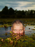 Ernie in pond with only eyes showing