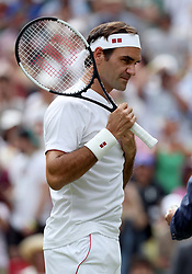 Roger Federer on day three of the Wimbledon Championships at the All England Lawn Tennis and Croquet Club, Wimbledon.