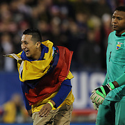 An Ecuador fan runs onto the pitch to greet  Ecuador goalkeeper Máximo Banguera during the USA Vs Ecuador International match at Rentschler Field, Hartford, Connecticut. USA. 10th October 2014. Photo Tim Clayton