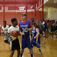 Clayton Dabbs of Oxford tries to block Tanarious Martin of Greenwood during Saturday's Special Olympics Mississippi Spring Games basketball tournament