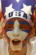 A fan cheers after the US beat China in the womens World Cup final.  Photo by Rick Wilking