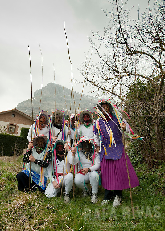 Momotxorros pose before taking part in the ancient carnival of Unanu, North of Navarra province in Spain, on March 8, 2011. Momotxorros chase locals and slash them with sticks.   PHOTO/ RAFA RIVAS