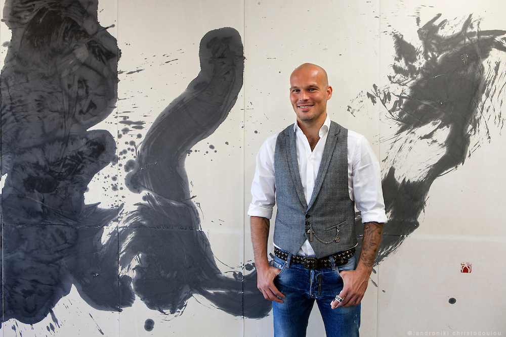 Fredrik Ljungberg in front of a Japanese calligraphy painting in one of the rooms of the S-PULSE footbal team's club building