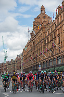 The peloton passes Harrods in Knightsbridge in the Prudential RideLondon-Surrey Classic 30/07/2017<br /> <br /> Photo: Jon Buckle/Silverhub for Prudential RideLondon<br /> <br /> Prudential RideLondon is the world's greatest festival of cycling, involving 100,000+ cyclists – from Olympic champions to a free family fun ride - riding in events over closed roads in London and Surrey over the weekend of 28th to 30th July 2017. <br /> <br /> See www.PrudentialRideLondon.co.uk for more.<br /> <br /> For further information: media@londonmarathonevents.co.uk