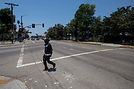 A pedestrian crosses a section of Rodeo Road that will be renamed Obama Boulevard in honor of former President Barack Obama, June 29, 2017, in Los Angeles. The Los Angeles City Council has voted unanimously to name a street for former President Obama. The motion approved 14-0 Wednesday calls for the city engineer to begin the process of renaming several miles of Rodeo Road as Obama Boulevard.(Photo by Ringo Chiu)<br /> <br /> Usage Notes: This content is intended for editorial use only. For other uses, additional clearances may be required.