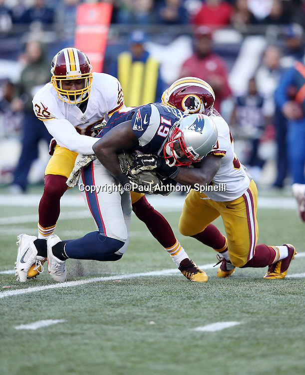 New England Patriots wide receiver Brandon LaFell (19) catches a fourth quarter pass for a first down as he gets gang tackled by Washington Redskins cornerback Chris Culliver (29) and Washington Redskins defensive back Jeron Johnson (20) during the 2015 week 9 regular season NFL football game against the Washington Redskins on Sunday, Nov. 8, 2015 in Foxborough, Mass. The Patriots won the game 27-10. (©Paul Anthony Spinelli)