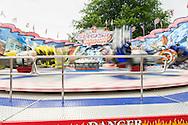 Nederland, Tilburg, 20160726<br /> De supersnelle moves van de Ghost Rider. De beweging is vervaagd.<br /> Kermis in Tilburg. De grootste kermis van Nederland en de Benelux.<br /> Op het kilometers lange parcours staan tientallen attracties <br /> <br /> Netherlands, Tilburg<br /> Funfair in Tilburg. The largest fair in the Netherlands and Benelux.<br /> dozens of attractions on the kilometer-long trail