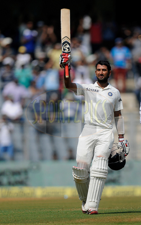 Cheteshwar Pujara of India raises his bat after scoring a century during day two of the second Star Sports test match between India and The West Indies held at The Wankhede Stadium in Mumbai, India on the 15th November 2013<br /> <br /> This test match is the 200th test match for Sachin Tendulkar and his last for India.  After a career spanning more than 24yrs Sachin is retiring from cricket and this test match is his last appearance on the field of play.<br /> <br /> <br /> Photo by: Pal PIllai - BCCI - SPORTZPICS<br /> <br /> Use of this image is subject to the terms and conditions as outlined by the BCCI. These terms can be found by following this link:<br /> <br /> http://sportzpics.photoshelter.com/gallery/BCCI-Image-Terms/G0000ahUVIIEBQ84/C0000whs75.ajndY