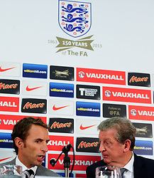 File photo dated 27-08-2013 of England U21's Manager Gareth Southgate and England Manager Roy Hodgson (right)