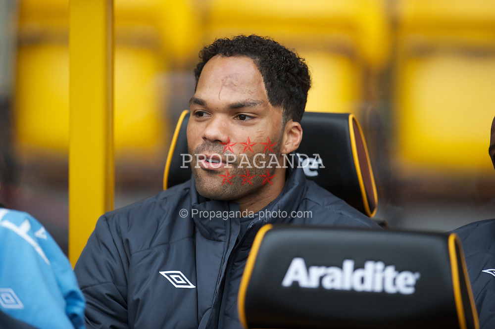WOLVERHAMPTON, ENGLAND - Saturday, October 30, 2010: Manchester City's Joleon Lescott on the bench before the Premiership match against Wolverhampton Wanderers at Molineux. (Pic by: David Rawcliffe/Propaganda)