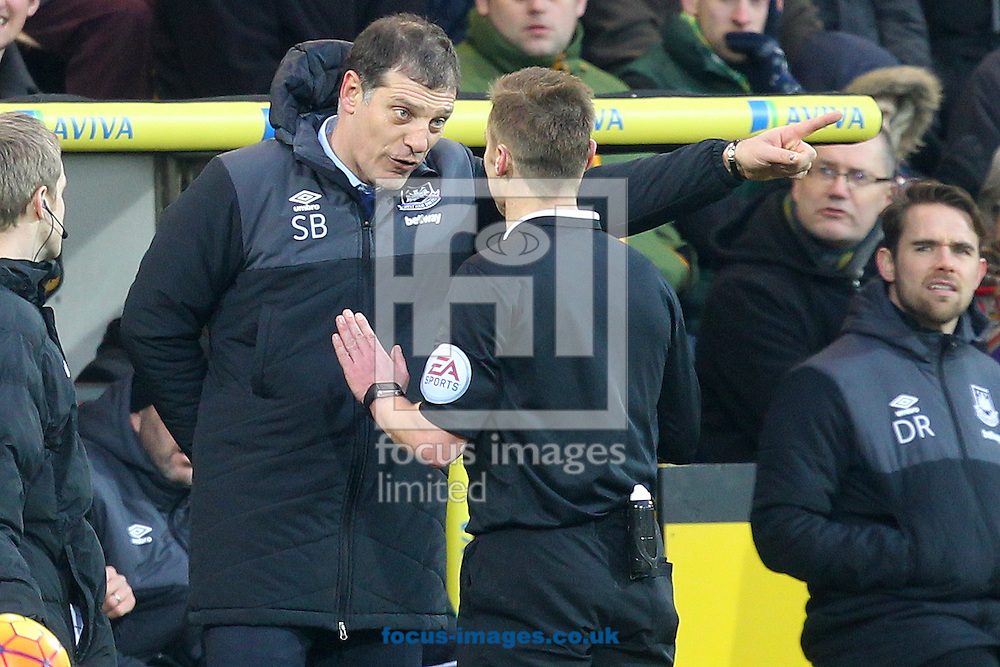 West Ham Manager Slaven Bilic is spoken to by Referee Michael Jones during the Barclays Premier League match at Carrow Road, Norwich<br /> Picture by Paul Chesterton/Focus Images Ltd +44 7904 640267<br /> 13/02/2016