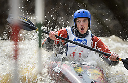 "Hunter Smoak of Ames, Iowa races in the K1 men's Novice/Expert class on the slalom course of the 45th Annual Missouri Whitewater Championships. Smoak placed fifth in the class and first in the downriver K1 Men's Novice class. The Missouri Whitewater Championships, held on the St. Francis River at the Millstream Gardens Conservation Area, is the oldest regional whitewater slalom race in the United States. Heavy rain in the days prior to the competition sent water levels on the St. Francis River to some of the highest heights that the race has ever been run. Only expert classes were run on the flood level race course. Novices who chose to race were re-classified as ""novice experts"" to recognize their achievements."