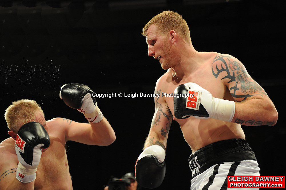Tom Dallas (white shorts) defeats Lee Swaby at Gorsebrook Leisure Centre Dagenham on 14th May 2010. Frank Maloney Promotions. Photo credit: © Leigh Dawney