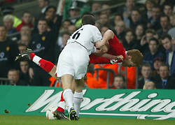 CARDIFF, WALES - Sunday, March 2, 2003: Manchester United's Roy Keane throws Liverpool's John Arne Riise to the ground during the Football League Cup Final at the Millennium Stadium. (Pic by David Rawcliffe/Propaganda)