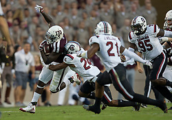 Texas A&M running back Keith Ford (7) rushes for a first down against South Carolina defensive back D.J. Smith (24) during the first quarter of an NCAA college football game Saturday, Sept. 30, 2017, in College Station, Texas. (AP Photo/Sam Craft)