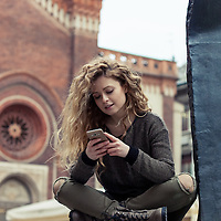 young blonde woman texting on het smartphone