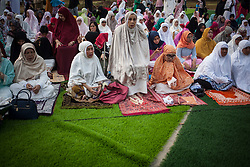 February 14, 2013 - Central Jakarta, Jakarta, Indonesia - Women during Eid Al-Fitr prayer on plastic grass at futsal stadium on June 15, 2018 in Jakarta, Indonesia. Muslims around the world are celebrating Eid al-Fitr, the three day festival marking the end of the Muslim holy month of Ramadan, it will be observed on 15th or 16th of June depending on the lunar calendar. Eid al-Fitr is one of the two major holidays in Islam. (Credit Image: © Afriadi Hikmal via ZUMA Wire)