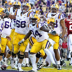 November 6, 2010; Baton Rouge, LA, USA;  LSU Tigers running back Stevan Ridley (34) celebrates after scoring a touchdown during the second half against the Alabama Crimson Tide at Tiger Stadium. LSU defeated Alabama 24-21.  Mandatory Credit: Derick E. Hingle