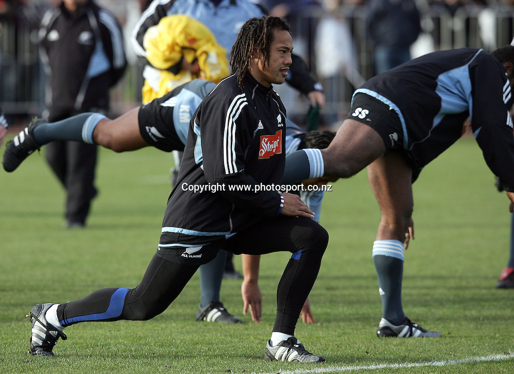All Black captain Tana Umaga does stretches during a training session held at QE II Park, Christchurch, New Zealand, on Monday 20 June, 2005. Photo: PHOTOSPORT<br />