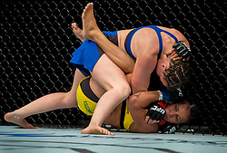 Leslie Smith (Blue) in action against Amanda Lemos in their bantamweight bout during the UFC Fight Night at the SSE Hyrdo, Glasgow.