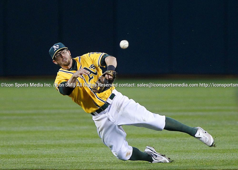 March 31, 2014 - Oakland, CA, USA - Oakland Athletics second baseman Eric Sogard throws to first after fielding a ground ball in the second inning against the Cleveland Indians on Opening Day, Monday, March 31, 2014 at O.co Coliseum in Oakland, Calif