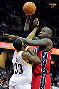 March 23, 2010; Cleveland, OH, USA; New Jersey Nets center Johan Petro (27) shoots over Cleveland Cavaliers shooting guard Alonzo Gee (33) during the third quarter at Quicken Loans Arena. The Nets beat the Cavaliers 98-94 in overtime. Mandatory Credit: Jason Miller-US PRESSWIRE