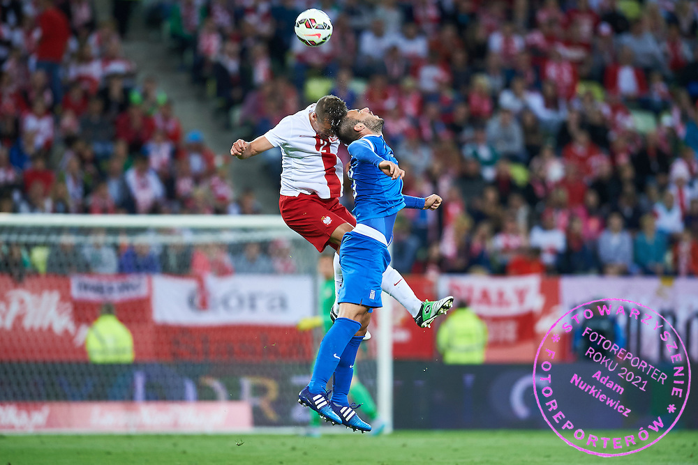 (L) Thiago Cionek from Poland fights for the ball during international friendly soccer match between Poland and Greece at PGE Arena Stadium on June 16, 2015 in Gdansk, Poland.<br /> Poland, Gdansk, June 16, 2015<br /> <br /> Picture also available in RAW (NEF) or TIFF format on special request.<br /> <br /> For editorial use only. Any commercial or promotional use requires permission.<br /> <br /> Adam Nurkiewicz declares that he has no rights to the image of people at the photographs of his authorship.<br /> <br /> Mandatory credit:<br /> Photo by &copy; Adam Nurkiewicz / Mediasport