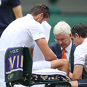 LONDON, ENGLAND - JULY 16: Marin Cilic of Croatia distraught in his chair as he receives treatment for blisters during his natch against Roger Federer of Switzerland in the Gentlemen's Singles final of the Wimbledon Lawn Tennis Championships at the All England Lawn Tennis and Croquet Club at Wimbledon on July 16, 2017 in London, England. (Photo by Tim Clayton/Corbis via Getty Images)