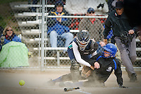 JEROME A. POLLOS/Press..Coeur d'Alene's Danielle Erickson comes to rest on top of home plate after colliding with Lake City catcher Brittani Waide who lost the ball upon impact.