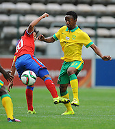 CAPE TOWN, SOUTH AFRICA - Sunday 27 September 2015: Marcelo Allende (captain) of Chile is challenged by Tebogo Qinisele of South Africa during the U17 International friendly soccer match between South Africa v Chile at Athlete Stadium. (Photo by Roger Sedres/ImageSA)