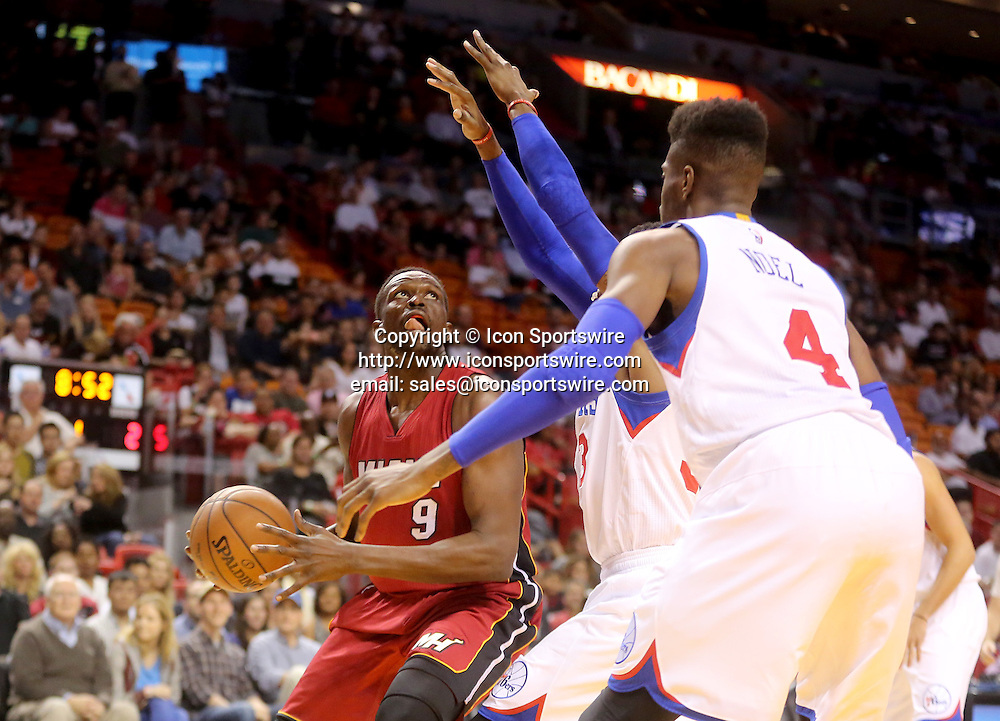 Dec. 23, 2014 - Miami, FL - Florida, USA - United States - fl-heat-76ers-1223e -  Luol Deng of the Miami Heat goes up for a basket against the Philadelphia 76ers.