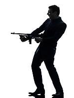 one  man holding thompson machine gun in silhouette on white background