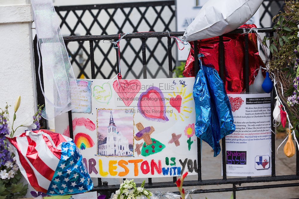 The city continues to mourn as flowers and signs decorate a makeshift memorial outside the historic Mother Emanuel African Methodist Episcopal Church June 22, 2015 in Charleston, South Carolina. Nine people killed at the church by white supremacist, Dylann Storm Roof last Wednesday.