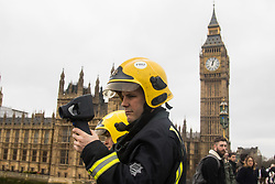 Westminster, London, March 29th 2017. One week after the terror attack on Westminster bridge, it is once again the scene of an emergency services operation as police, ambulance and fire crews search the river after a person jumped from the bridge. The person has not so far been recovered.<br /> PICTURED:  Fire and rescue officers use an infra red camera to search the Thames.<br /> CREDIT: ©Paul Davey<br /> FOR LICENCING CONTACT: Paul Davey +44 (0) 7966 016 296 paul@pauldaveycreative.co.uk