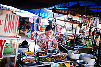 A woman selling Hu Tieu noodles at the local market in Chau Doc, Vietnam.