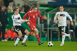 MONCHENGLADBACH, GERMANY - Wednesday, October 15, 2008: Wales' captain Craig Bellamy and Germany's Philipp Lahm during the 2010 FIFA World Cup South Africa Qualifying Group 4 match at the Borussia-Park Stadium. (Photo by David Rawcliffe/Propaganda)