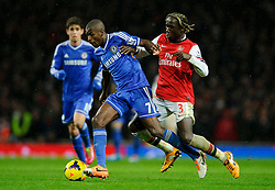 Chelsea Midfielder Ramires (BRA) is tackled by Arsenal Defender Bacary Sagna (FRA) during the second half of the match - Photo mandatory by-line: Rogan Thomson/JMP - Tel: Mobile: 07966 386802 - 23/12/2013 - SPORT - FOOTBALL - Emirates Stadium - Arsenal v Chelsea - Barclays Premier League.