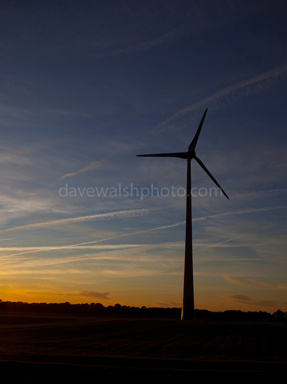 Wind Turbines, at sunset in Flevoland, the Netherlands.