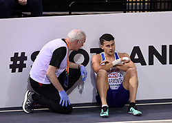 Great Britain's Guy Learmonth (right) is consoled by a medic after falling in the second semi final of the Men's 800m during day two of the European Indoor Athletics Championships at the Emirates Arena, Glasgow.