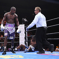Willie Nelson (L) knocks out Tony Harrison during their Premier Boxing Champions boxing match on ESPN at the USF Sun Dome, on Saturday, July 11, 2015 in Tampa, Florida.  Nelson won the match by TKO. (AP Photo/Alex Menendez)
