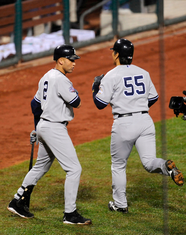 PHILADELPHIA - OCTOBER 31: Hideki Matsui #55 of the New York Yankees celebrates with teammate Derek Jeter #2 after hitting a home run against the Philadelphia Phillies in Game Three of the 2009 MLB World Series at Citizens Bank Park on October 31, 2009 in Philadelphia, Pennsylvania. The Yankees defeated the Phillies 8 to 5.(Photo by Rob Tringali/Sportschrome) *** Local Caption *** Hideki Matsui;Derek Jeter